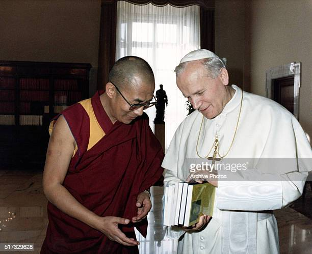 9/28/1982Vatican City Rome Italy Dalai Lama the exiled spiritual leader of Tibet is shown with Pope John Paul II during an audience at the Vatican...