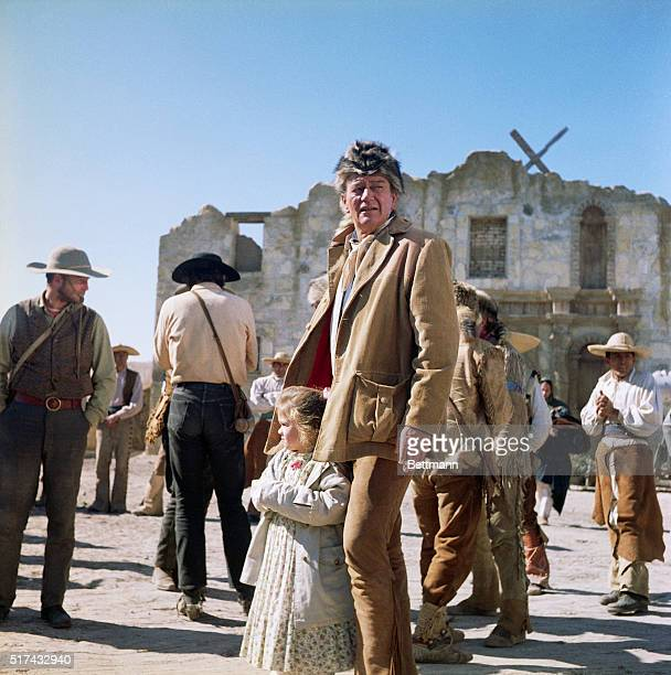 9/29/1960Hollywood CA John Wayne stands with his daughter Aissa on the set of The Alamo