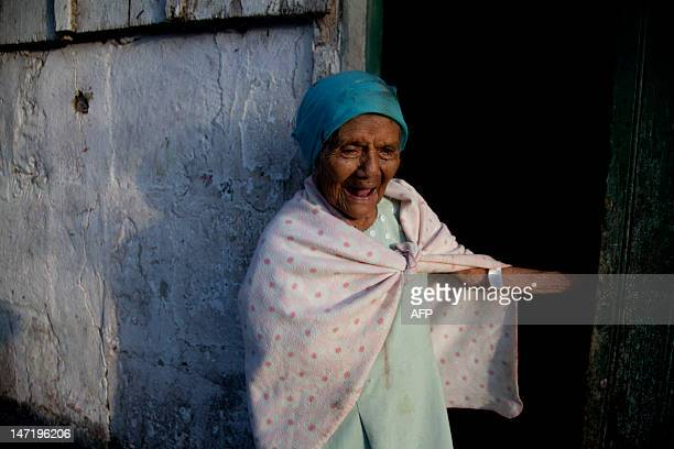A 92yearold greatgrandmother watches from her front door as Catholic faithfuls take part in the last day of celebrations for the nativity of John the...