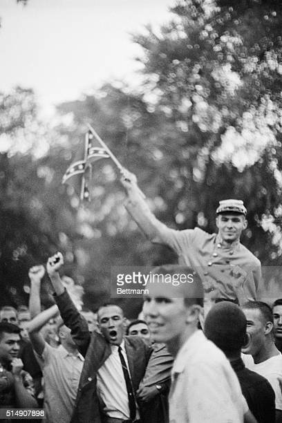 9/30/1962Oxford MS Students one of them waving a Confederate flag shout insults at US marshals who surrounded the administration building at the Univ...