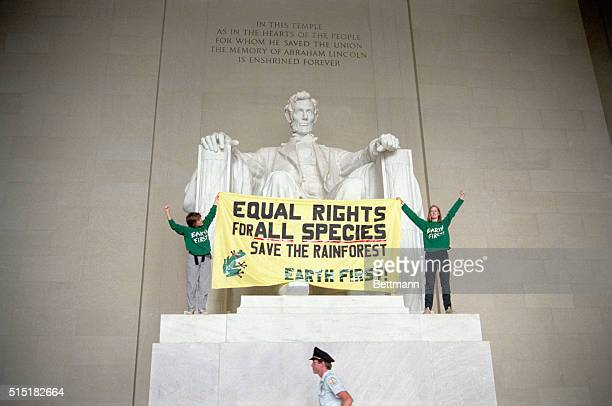 9/30/1987Washington DC Two members of the environmental group Earth First hold a sign in front of the Lincoln Memorial to protest the destruction of...
