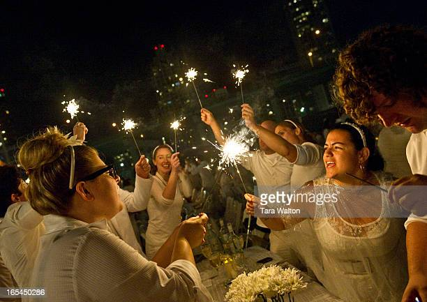 30pm marks to lighting of sparklers for dinner guests followed by dancing Diner en Blanc pops up in Toronto's Fort York Thursday August 9 2012 The...