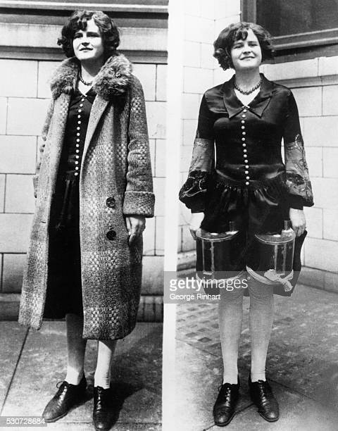 9/3/1928Woman wearing floppy overcoat which conceals two tins of booze strapped to her thighs
