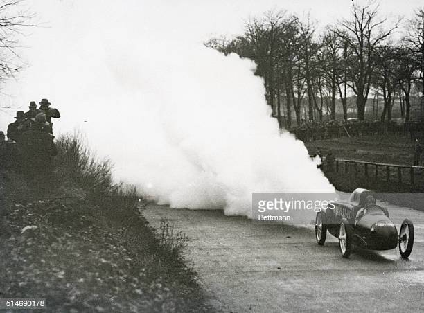 Berlin, Germany: The new Volkart rocket car during a test spin in which it made 97 miles per hour. The exploding rockets in rear throw up a great...