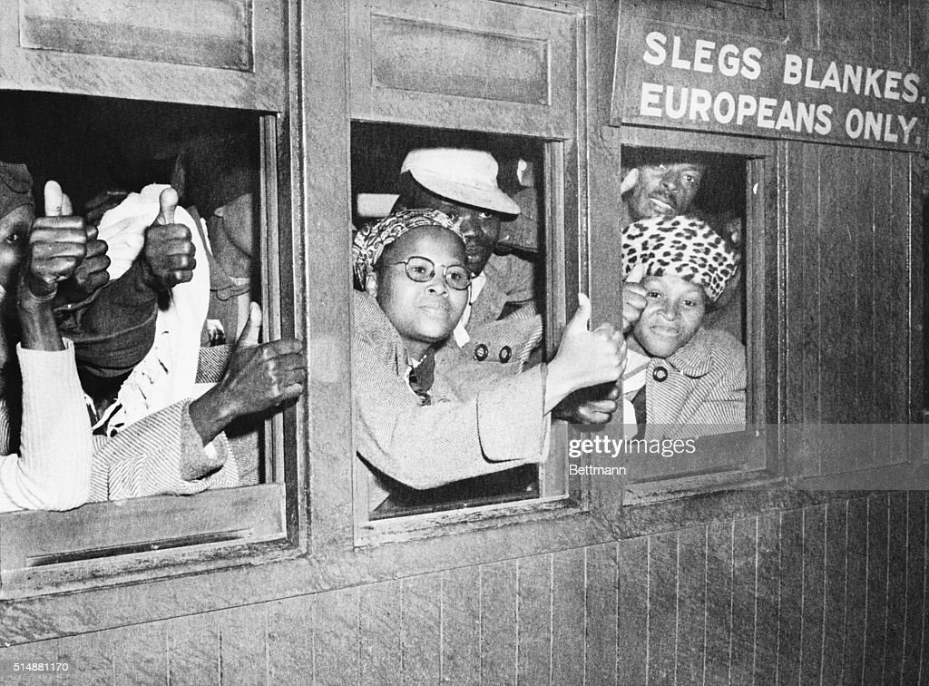 In flat definace of Prime Minister Malan's white supremacy laws and their rigid segregation rules, these South African natives took over a train compartment marked 'For Europeans Only' and rode into Cape Town, shouting their slogan 'Africa.' Thirty-four were arrested by Cape Town police. They are giving the 'thumbs up' here before they were taken from the train.
