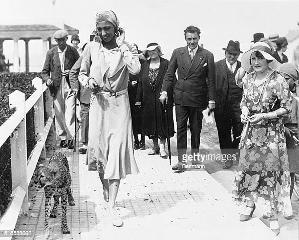 Deauville, France- Josephine Baker, colored American musical comedy star, as she gave Deauville a thrill by promenading with her latest pet, a baby...