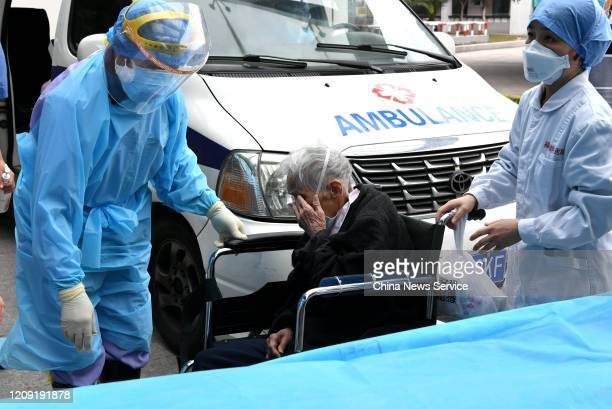 Year-old coronavirus-infected patient, who has been cured, is discharged from Fuzhou Pulmonary Hospital on February 27, 2020 in Fuzhou, Fujian...