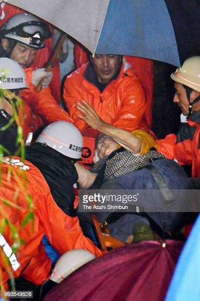 93yearold Kumiko Tonohata is rescued 24 hours after a landslide hit her house on July 7 2018 in Higashihiroshima Hiroshima Japan 51 people were...