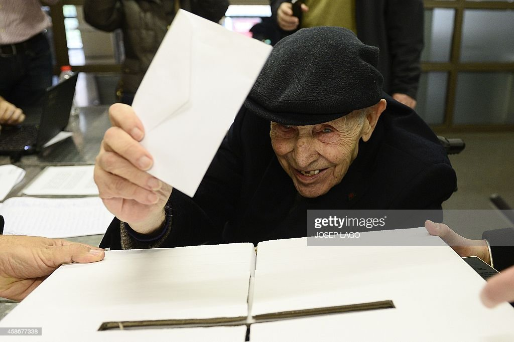A 93-year-old man cast his ballot on November 9, 2014 during a symbolic vote on independence for Catalonia from Spain at a polling station in Barcelona. One of Spain's biggest and richest regions, Catalonia defied Madrid today and proceeded with a symbolic vote on whether it should break away as an independent state.