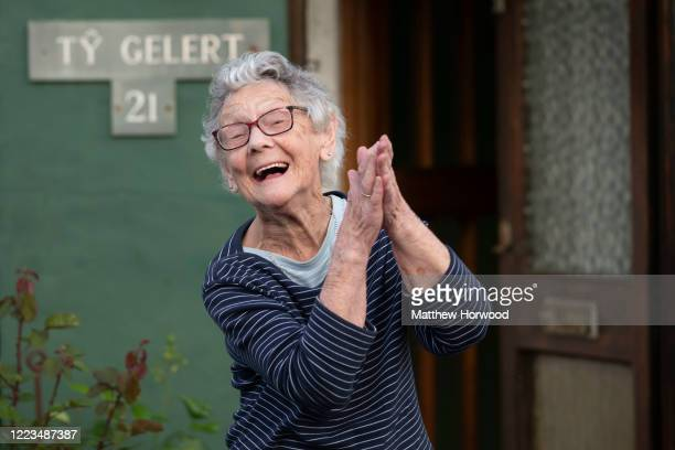 """Year-old woman claps from her house on Sudcroft Street on May 07, 2020 in Cardiff, United Kingdom. Following the success of the """"Clap for Our Carers""""..."""
