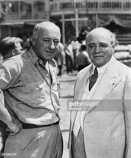 Los Angeles, CA: Cecil B. DeMille, movie director, entertained Albert Sarraut, former French Premier, on the set at the Paramount Studios, recently....
