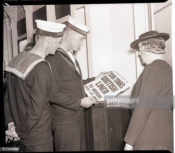 9/4/1939New York New York Sailors on Britain's Queen Mary gobble up the news from New York papers as the big ship docks after a perilous run from...