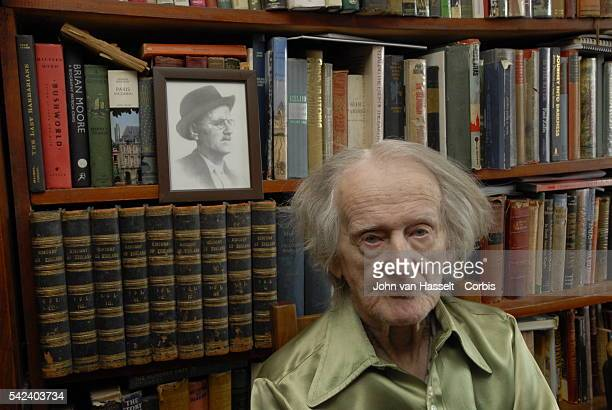 94yearold proprietor of the Shakespeare and Co Bookshop George Whitman sits in front of a portrait of James Joyce surrounded by books The Shakespeare...