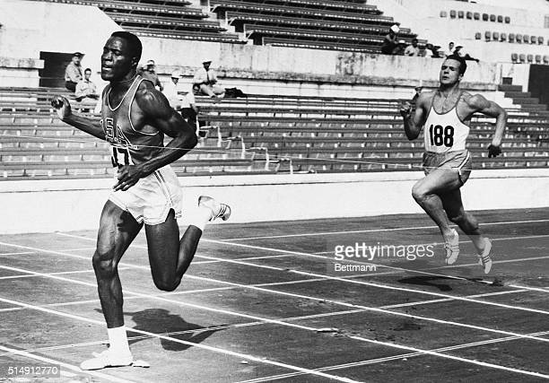 Rome, Italy- America's Rafer Johnson of Kingsburg, California sprints home to win his heat in the 100-meter dash, the first event in the decathlon....