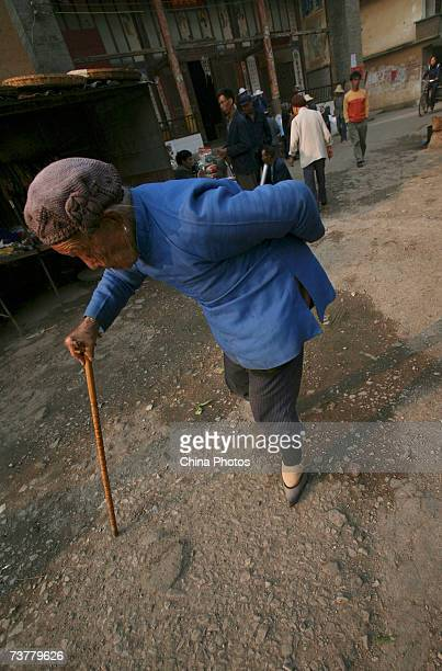A 95yearold bound feet woman walks at Liuyi Village on April 2 2007 in Tonghai County of Yunnan Province China Liuyi Village is known as the Bound...
