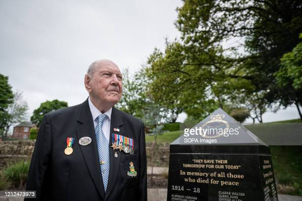 A 95yr old DDay veteran Lance Bombardier Roy Smith Royal Artillery stands alone at the war memorial in Royton park The VE Day 75th anniversary when...