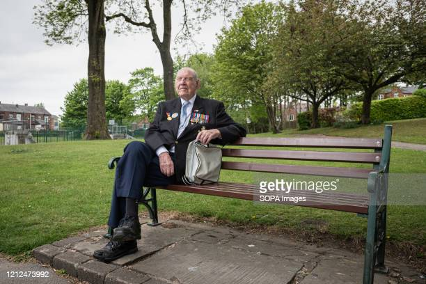 A 95yr old DDay veteran Lance Bombardier Roy Smith Royal Artillery sits alone at the Royton park during the commemoration The VE Day 75th anniversary...