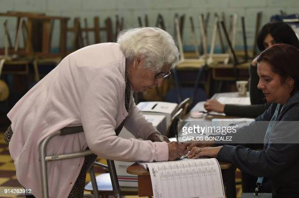 96yearold Berta Carrillo Ulate prepares to cast her vote at a polling station set up at Carlos Sanabria elementary school in San Jose during Costa...