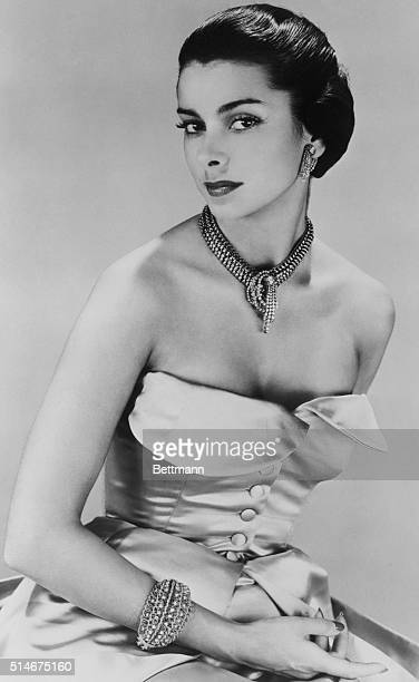 9/7/1948Paris France Strapless buttoned bosom of Balenciga's gleaming satin evening gown is made in the palest of blues Necklace is of diamond...