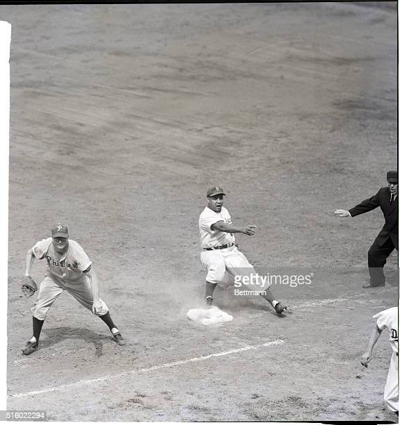 Catcher Roy Campanella of the Brooklyn Dodgers gets back to first base safe in the fifth inning of the first game of the DodgersPhillies double...