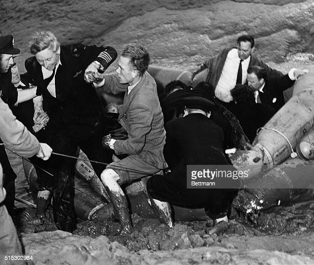 9/7/1954Shannon Airport Ireland Commodore A Viruly Captain of the Illfated KLM Constellation which crashed in the Shannon River is taken ashore from...