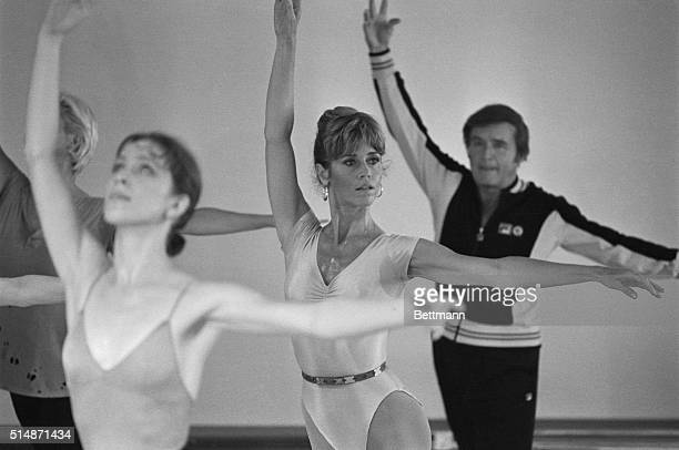 "Hollywood, CA: Actress Jane Fonda goes through some ballet exercise with talk show narrator Mike Douglas during taping of the ""Mike Douglas Show""..."