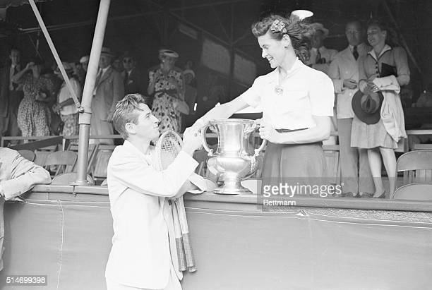 9/7/41Forest Hills New York Mrs Sarah Palfrey Cooke who earlier defeated Miss Pauline Betz for the women's national singles title congratulates Bobby...