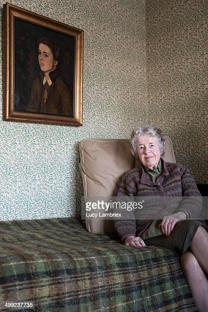 97-year-old posing next to portrait of herself