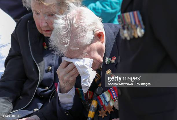 97yearold World War Two veteran Jimmy Ockendon wipes away tears during a memorial service at the DDay stone in Southsea on the 75th anniversary of...