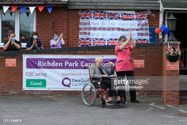 98yearold care home resident Albert Rose carers and staff applaud him outside Richden Park care home in Scunthorpe northern England on May 4...