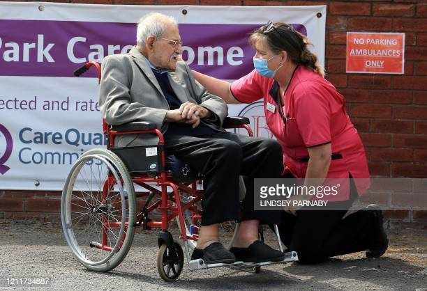 98yearold care home resident Albert Rose reacts as he talks with carer Jeanette outside Richden Park care home in Scunthorpe northern England on May...