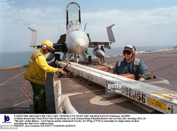 Jpg Aboard The USS Carl Vinson In The Arabian Gulf- Aviation Boatswains Mate First Class Ivan Borja And Airman Doug SchaeferStow The Tow Bar After...