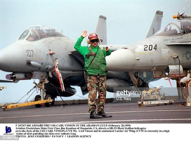 Jpg Aboard The USS Carl Vinson In The Arabian Gulf- Aviation Electricians Mate First Class Jim Knudsen Of Oceanside, Ca, Directs A Sh-53 Black...