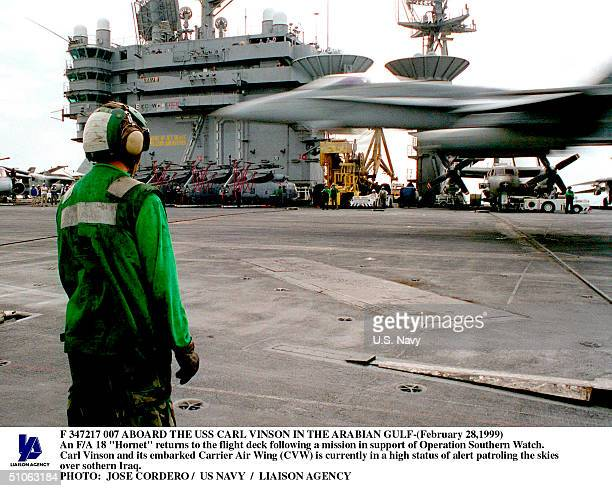 """Jpg Aboard The USS Carl Vinson In The Arabian Gulf- An F/A 18 """"Hornet"""" Returns To The Flight Deck Following A Mission In Support Of Operation..."""