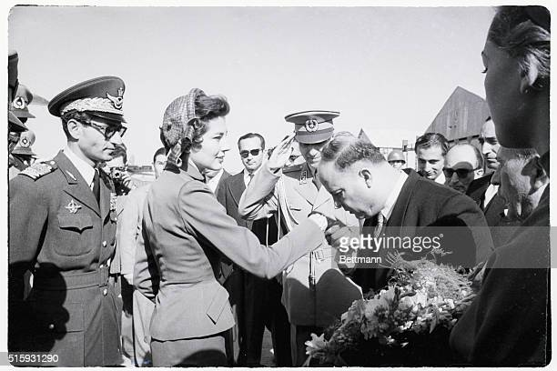Bending low the Mayor of Tehran kisses the hand of Iran's Queen Soraya as she returns from Rome to rejoin her husband Shah Mohammed Razi Pahlevi The...