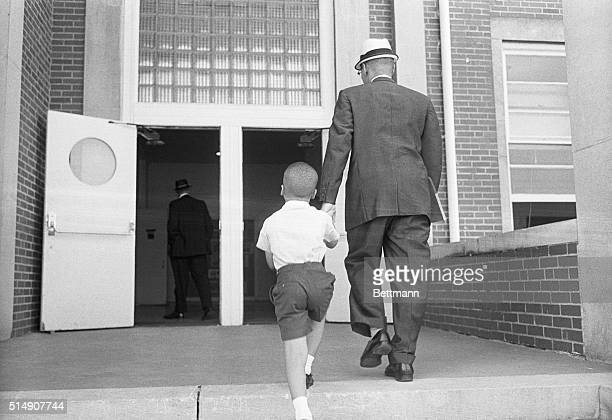 9/9/1963Huntsville AL Doors open wide ahead of him sixyearold Sonnie Hereford IV is escorted by his father to his first day of class in the formerly...