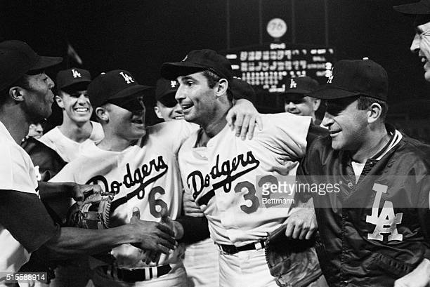 9/9/1965Los Angeles CA Dodger pitcher Sandy Koufax is mobbed by teammates on the field after pitching a perfect game Shown in the picture are Willie...