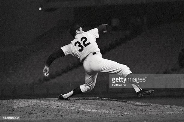 Los Angeles, CA: Sandy Koufax, who later claimed to have known all along he was pitching a no-hitter, shows the strain of a perfect game in this...