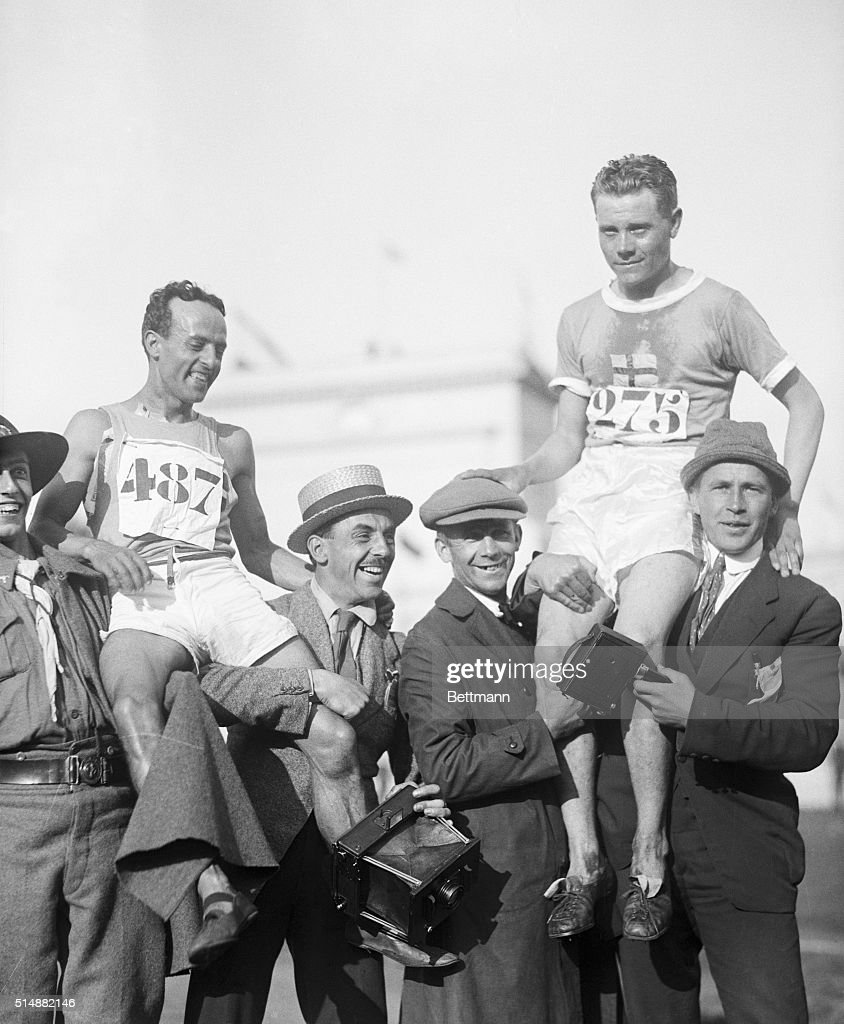 Paavo Nurmi of Finland (r) finishing first in 10,000 metre race and running mate Maccario of Italy who finished fourth on the shoulders of the crowd. BPA2#3450