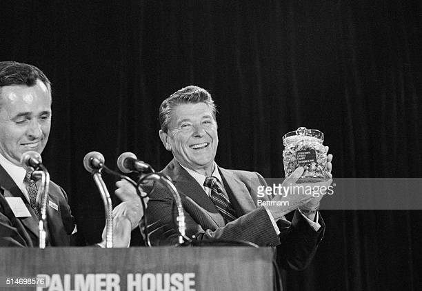 9/9/80Chicago Illinois Republican presidential candidate Ronald Reagan holds a crystal jar of jellybeans presented to him 9/9 by Clyde Dicky Jr...