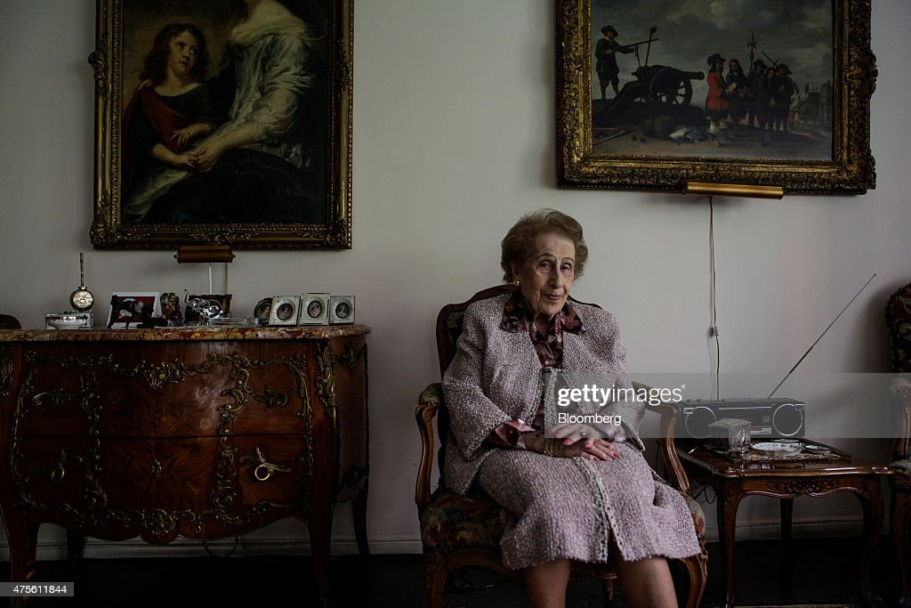 99-year-old Irene Bergman, financial adviser at Stralem & Co., sits for a photograph at her home in New York, U.S., on Saturday, May 30, 2015. As one of the oldest working professionals in an industry run by men half her age, Bergman offers a rare perspective. She recalls the small private firms founded by German Jews of the 19th century that came to define Wall Street before their partnership model gave way to public listings, and honor succumbed to an ever-fiercer push for profit. Photographer: Chris Goodney/Bloomberg via Getty Images