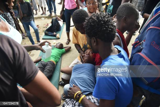 People are treated in the yard of the Immaculate Conception Hospital in the city of PortdePaix October 7 2018 following the earthquake A 59magnitude...