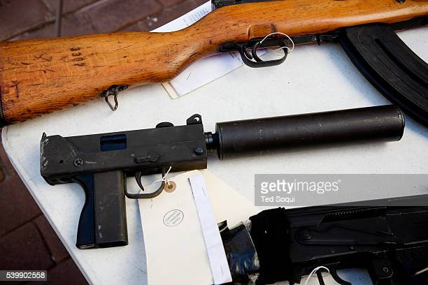 A 9mm machine pistol with silencer This gun is popular with gang members and drug dealers due to it's small size and easy concealment Los Angeles...