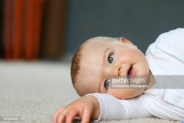 9mths old boy - lying on side stock pictures, royalty-free photos & images