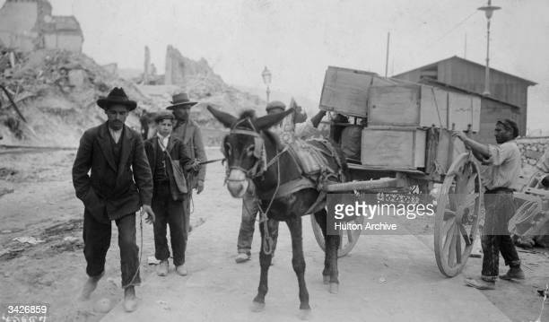 A donkey cart carrying coffins containg the dead from the earthquake at Messina