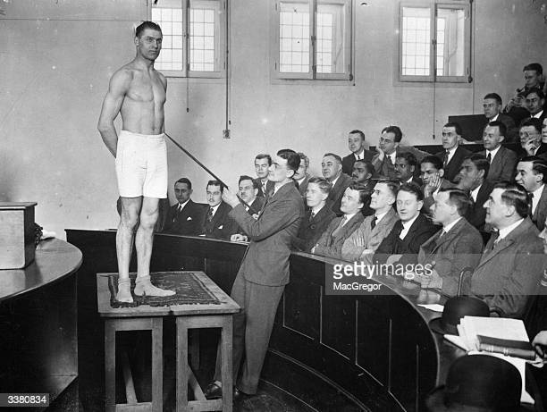 British Heavyweight Champion Phil Scott modelling before student doctors at the Middlesex Hospital London