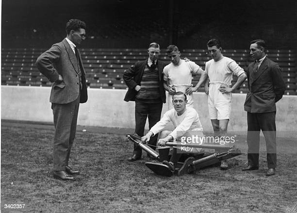 Manchester City Football Club captain J McMullen does some limb stretching exercises on a rowing machine in preparation for the FA Cup final between...