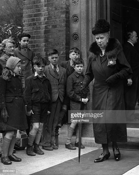 A group of children watch Queen Mary wife of King George V leave the Greek Church in Bayswater London after attending the Requiem Mass for the late...