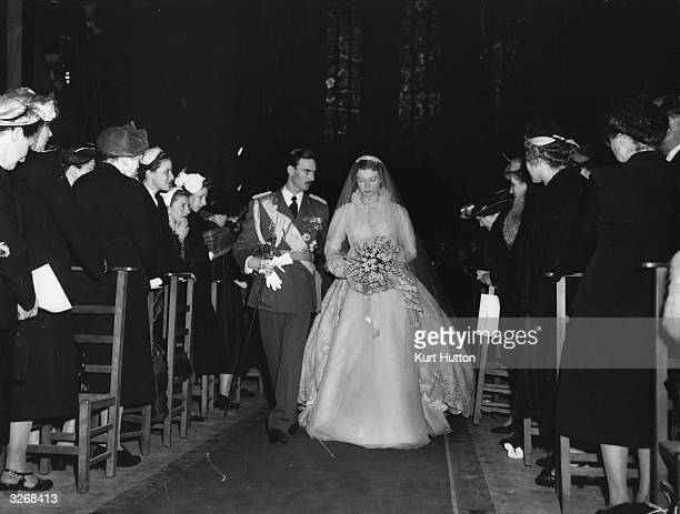 The bride and groom Princess Josephine-Charlotte of Belgium and Prince Jean of Luxembourg walking down the aisle of Luxembourg's 13th century...