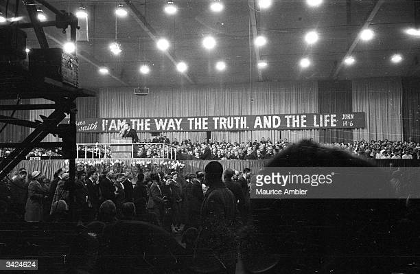 American evangelist Billy Graham begins his AllScotland Crusade in Kelvin Hall Glasgow in front of an audience of 15000 Billy Graham's Christian...